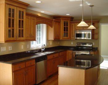 Tủ bếp gỗ Sồi Nga Inox 304 QC25 là mẫu tủ bếp gỗ tự nhiên thân thiện với môi trường và có sự kết hợp hài hòa giữa khung inox 304 sáng bóng, gỗ sồi Nga có độ chắc nặng và các ô của kinh cho tủ bếp trên tạo ra tính thẩm mỹ cao cho tủ bếp.