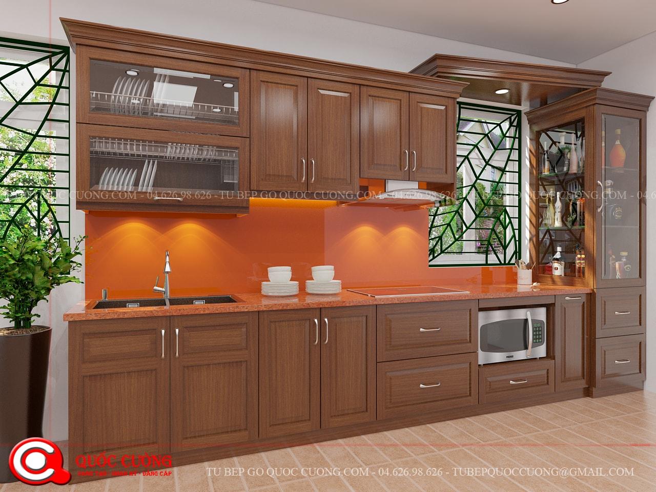 Tủ kế XD 018 được thiết kế theo phong cách tân cổ điển với kiểu dáng chữ I giúp tiết kiệm diện tích và tông màu nâu đậm sang trọng giúp tạo nên không gian căn bếp lịch lãm.
