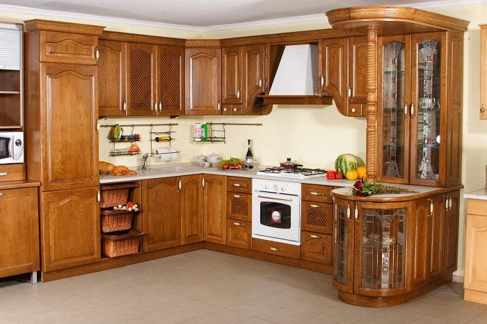 Mẫu tủ bếp làm từ chất liệu gỗ tự nhiên mang đến sự hoàn hảo cho gian bếp nhà bạn